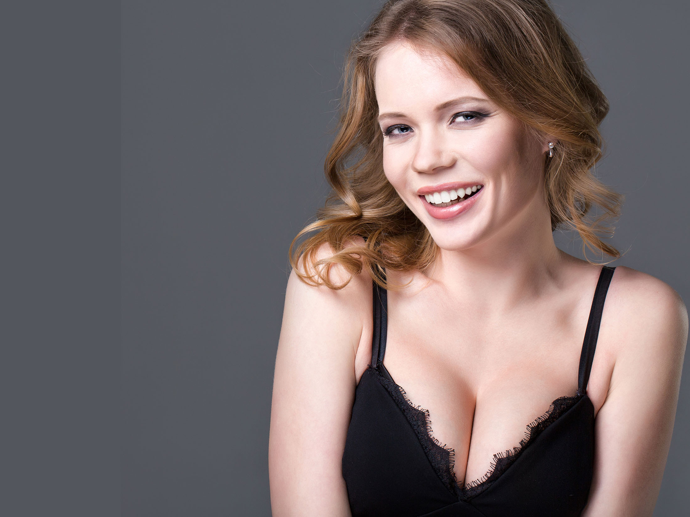 Happy woman after breast surgery